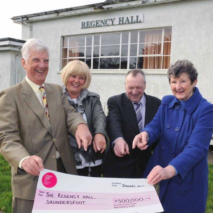 Committee members receiving the cheque for £500,000 from Big Lottery